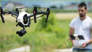 A man flying a drone. [Image Source: Ia.acs.org.au]